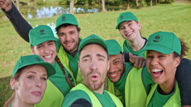 Young volunteers taking a selfie after finishing their local clean-up event