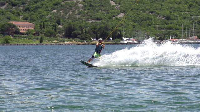 SLOW MOTION: Young wakeboarder jumping video