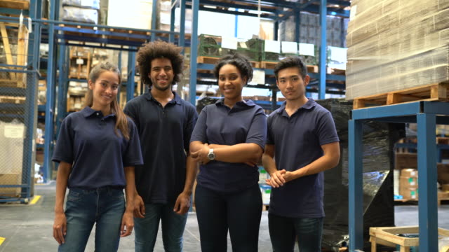 Young warehouse team standing in factory