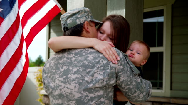 Young woman and baby say goodbye to soldier HD 1080p: Young woman and baby say goodbye to soldier camouflage clothing stock videos & royalty-free footage