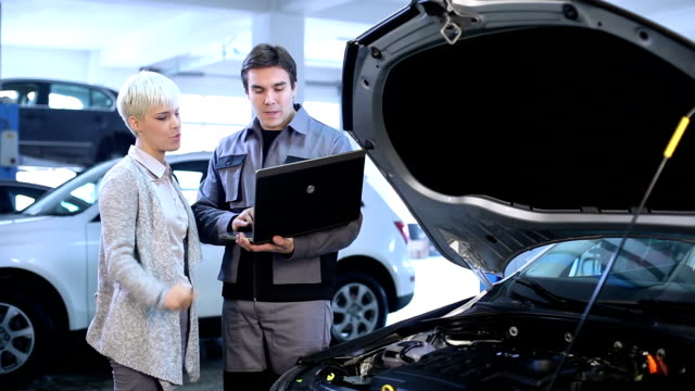 Young woman and mechanic. video