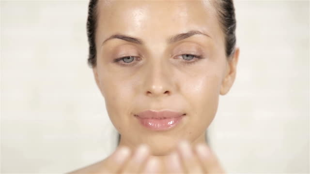 Young Woman Applying Face Cream video