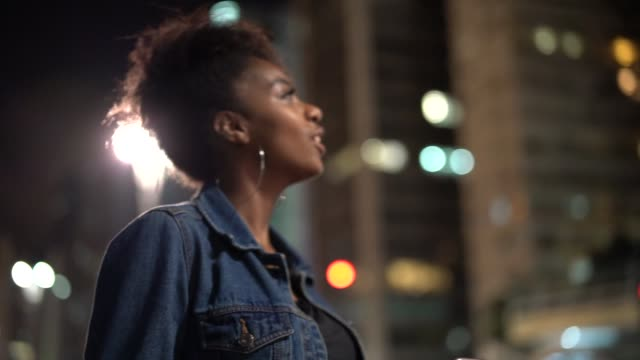 Young woman are so excited visiting the city at night video