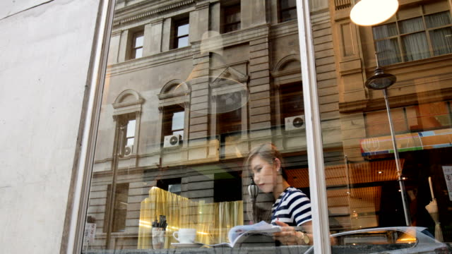 young woman at a coffee shop - melbourne stock videos & royalty-free footage