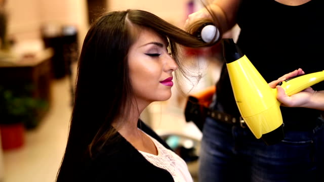 Young woman at a hair salon video