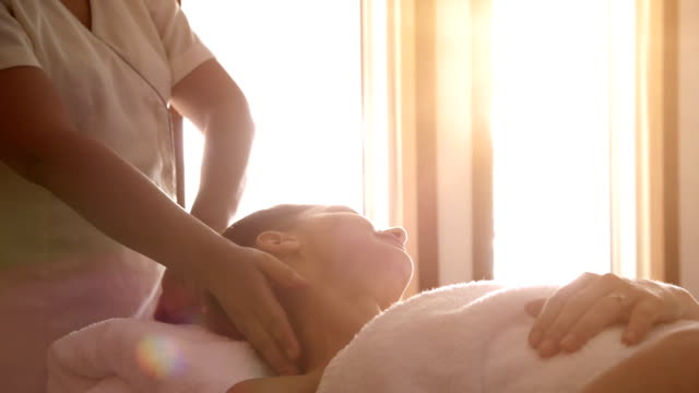 young woman at spa treatment - massage stok videoları ve detay görüntü çekimi