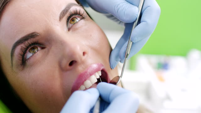 Young Woman At The Dentist video