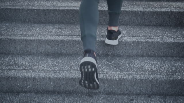 SLO MO Young woman athlete running up the stairs Young woman athlete running up the stairs,Slow motion staircases stock videos & royalty-free footage