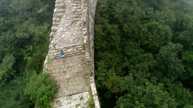 young woman backpacker hiking on the great wall in china video