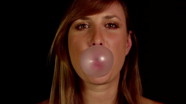 SLOW MOTION: Young woman blowing bubbles video