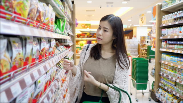 Young woman buying goods video