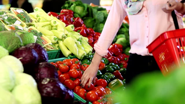 Young woman buying vegetable video