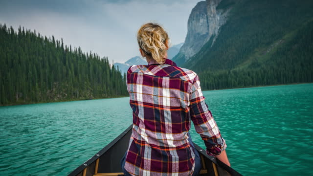 Young Woman Canoeing on Maligne Lake
