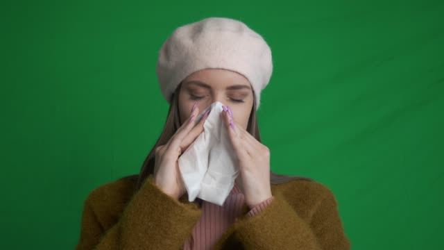 Young woman catching a cold video