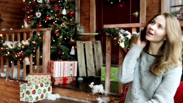Young woman celebrates Christmas. video