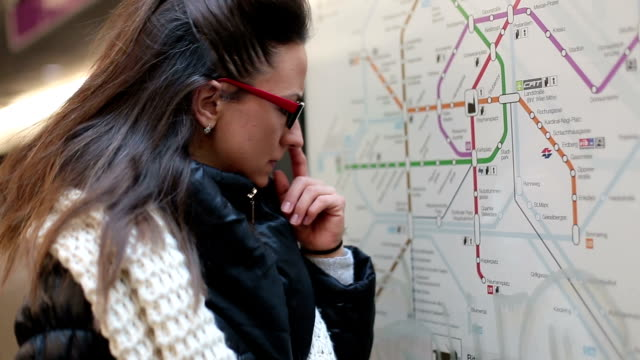 Young woman checking the tourist city map Young woman checking the tourist city map lost stock videos & royalty-free footage