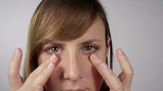Young woman checking wrinkles and pimples video