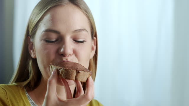 Young Woman Chocolate Spread Young Woman Chocolate Spread For Breakfast bread stock videos & royalty-free footage