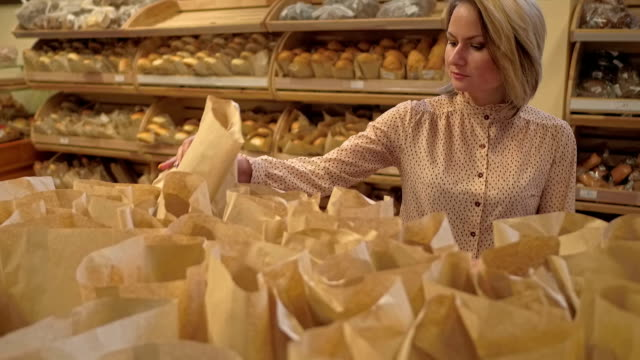 Young woman choosing bakery products video
