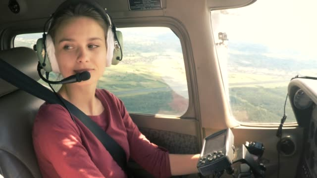 young woman civilian pilot - pilota video stock e b–roll