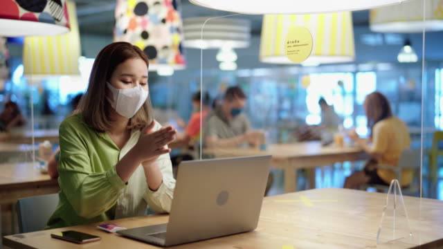 young woman cleaning and disinfect virus before using laptop - new normal video stock e b–roll