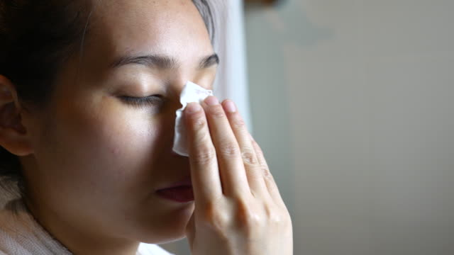 Young Woman cleaning face with cotton pad video