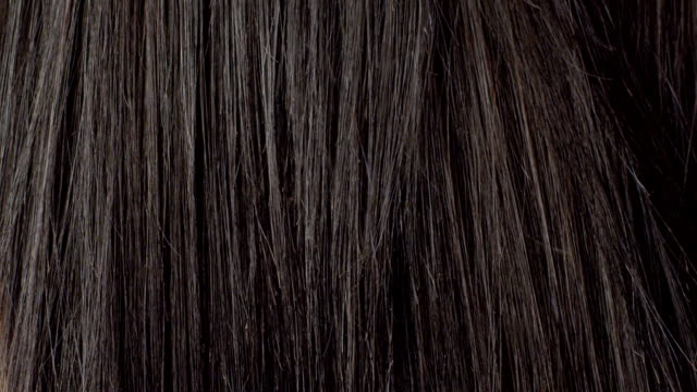 young woman combing her hair Woman with long healthy looking hair. Recorded by the camera RED scarlet at 2k. Color correction professionally done. hair stock videos & royalty-free footage