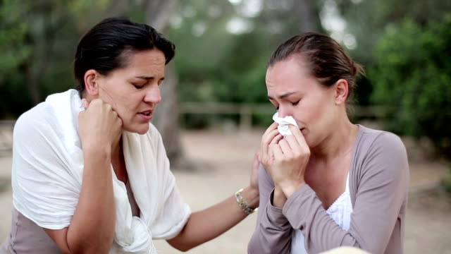 Young woman comforting tearful friend, outdoors video
