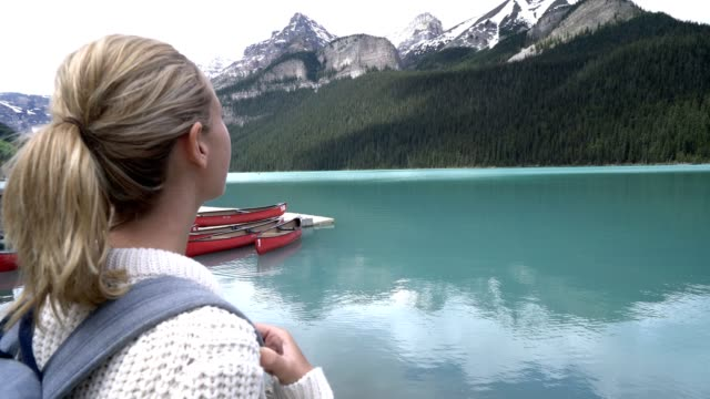 Young woman contemplating nature at Lake Louise video