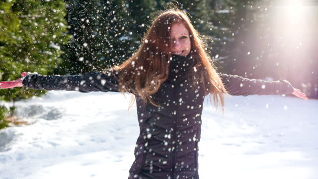 Young woman dancing in the snow video