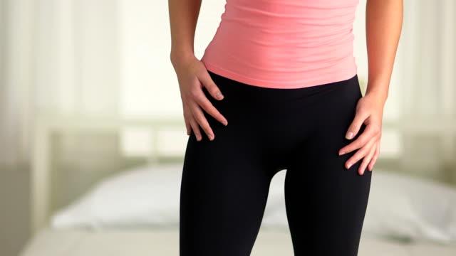 young woman dancing in yoga pants - strumpbyxor bildbanksvideor och videomaterial från bakom kulisserna