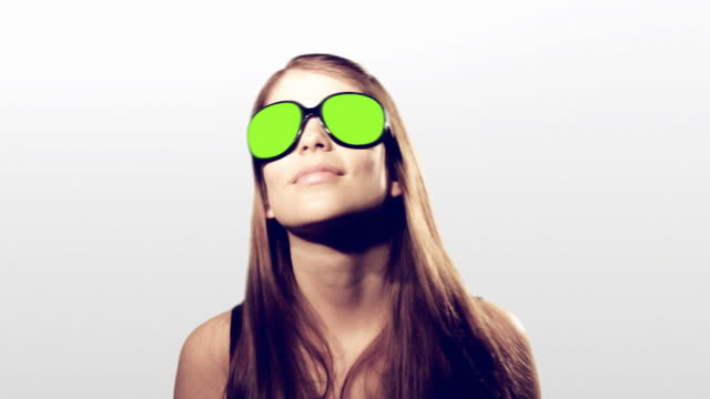 Young woman dancing with blinking colors sunglasses video