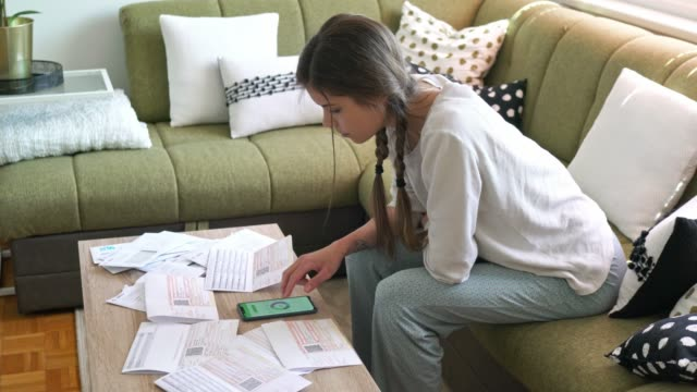 young woman dealing with grown up life - paying bills - online banking video stock e b–roll