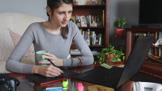 young woman designer working at home - sordità video stock e b–roll