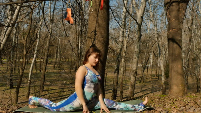 Young woman doing a split outdoors on carpet video