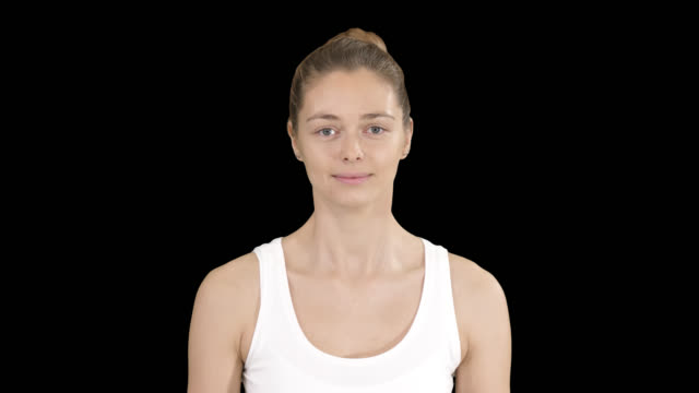 Young woman doing breathing exercise, Alpha Channel
