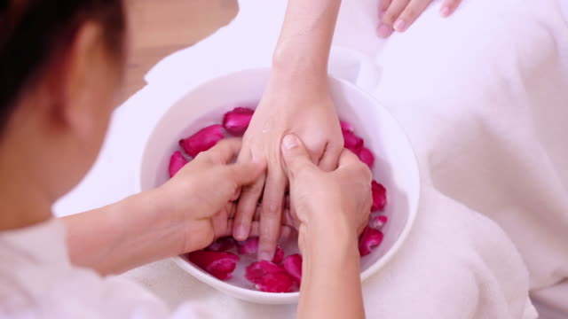 Young woman doing hand spa massage. video