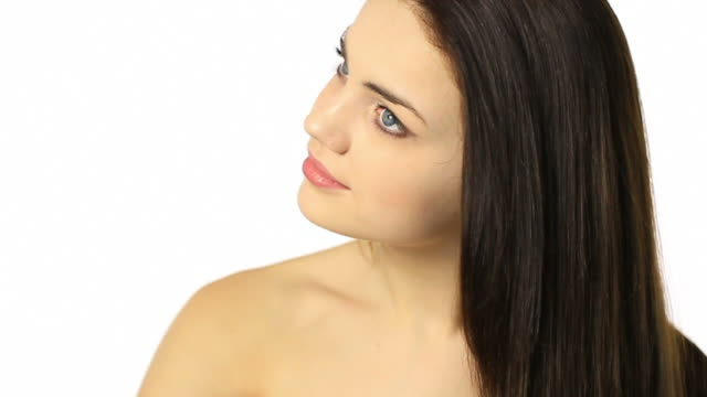 Young woman doing her beautiful hair Woman with long healthy looking hair  red lipstick stock videos & royalty-free footage