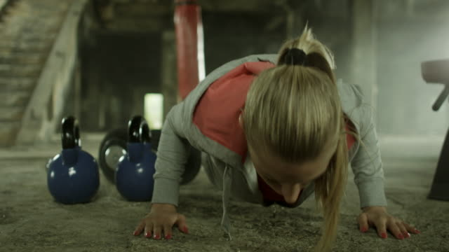 Young woman doing push ups video