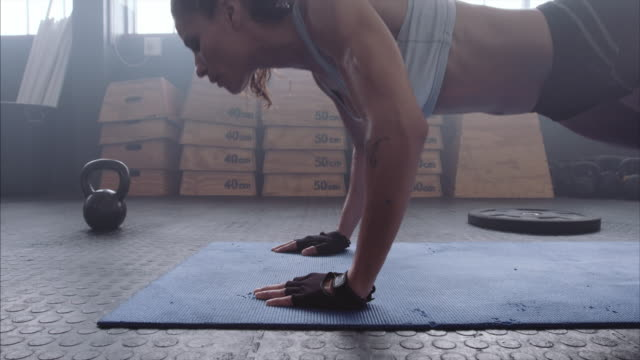 Young woman doing push-ups at the gym video