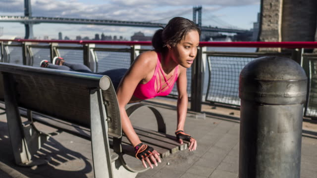 Young Woman Doing Pushups on Bench video