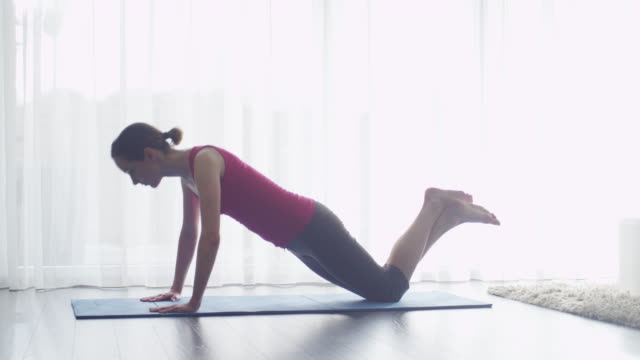 Young Woman doing Yoga at Living Room at Home video
