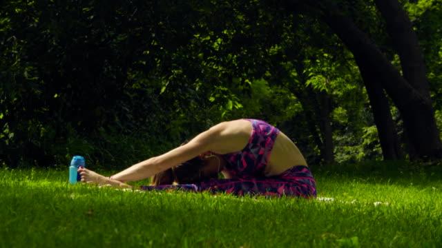 young woman doing yoga exercises - posizione corretta video stock e b–roll