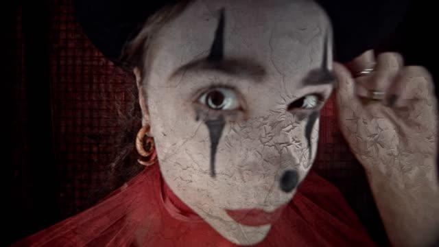 young woman dressed-up in evil clown costume for halloween - circus стоковые видео и кадры b-roll