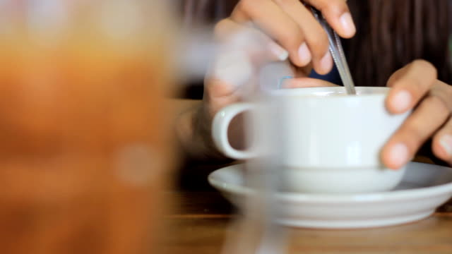 stockvideo's en b-roll-footage met young woman drink coffee - men blazer