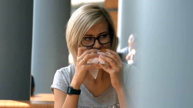 Young woman eating fast food video
