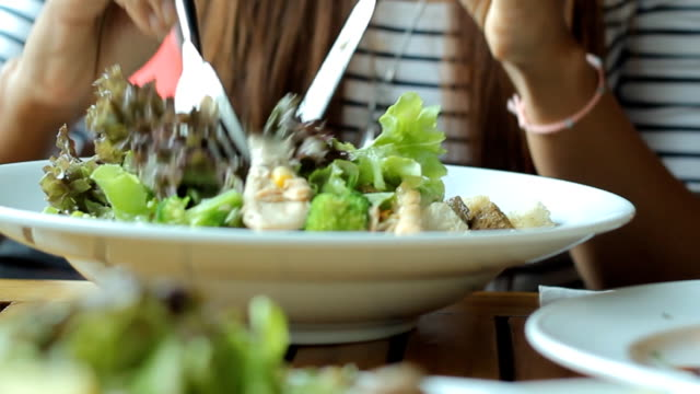 Young woman eating fresh salad video