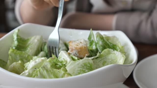 Young woman eating fresh salad video