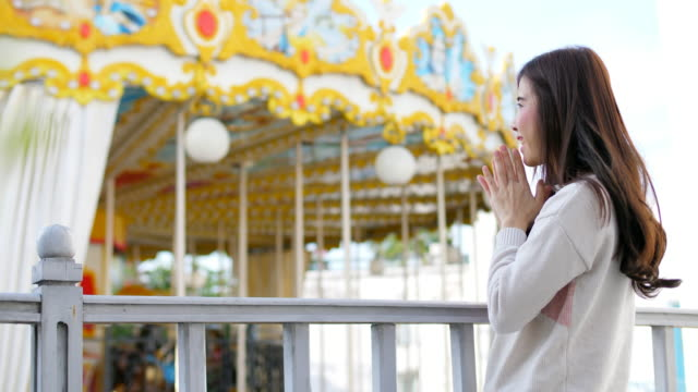 young woman enjoy merry go round - luna park video stock e b–roll