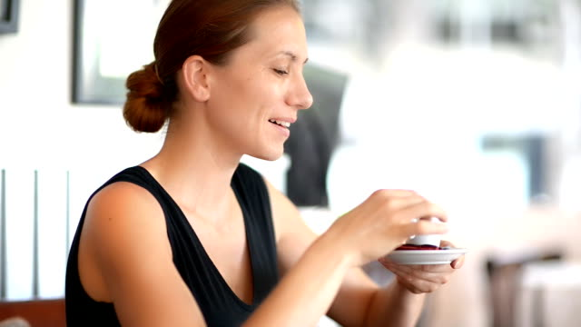 young woman enjoying coffee - desserts stock videos and b-roll footage